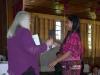 Board Member Mary Pliska Presenting Graduation Certificate